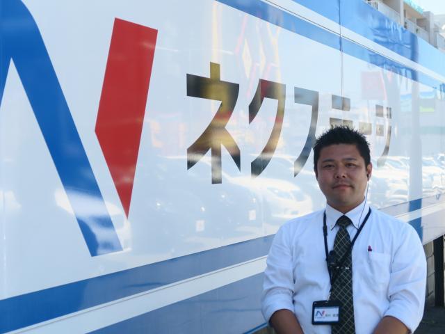 ネクステージのスタッフ写真 カーライフアドバイザー 岡村 範彦