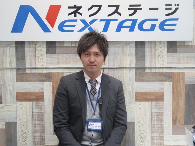 ネクステージのスタッフ写真 カーライフアドバイザー 吉成 威臣