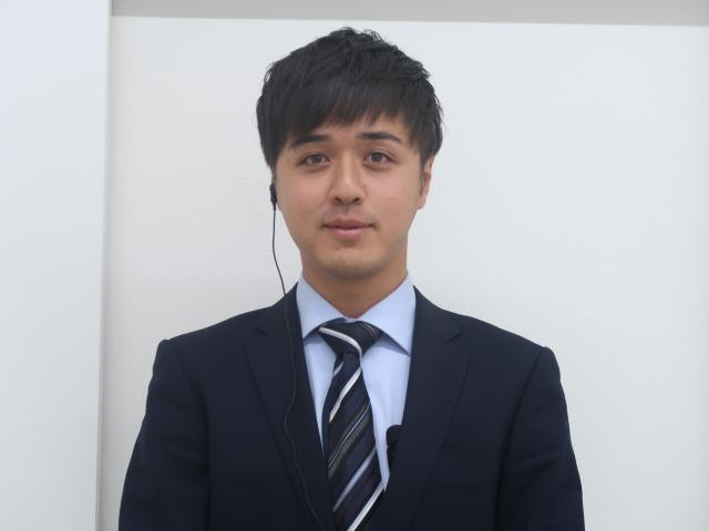 ネクステージのスタッフ写真 カーライフアドバイザー 日浦アミールレザー