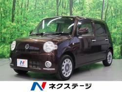 ミラココア ココアX 社外ナビTV・4WD・純正レザー調シートカバー・インテリキー・オートエアコンの中古車画像